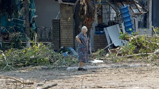 A woman stands in Donetsk, which was hit by shelling earlier today.
