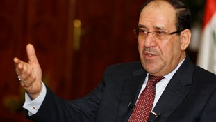 Iraq's Prime Minister Nuri al-Maliki speaks during an interview with Reuters.
