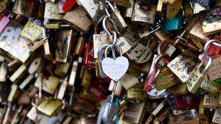 Lovelocks on a bridge in Paris.