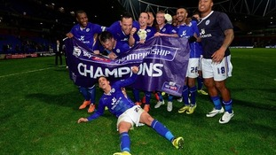 Leicester City players celebrate after winning the Championship title last season