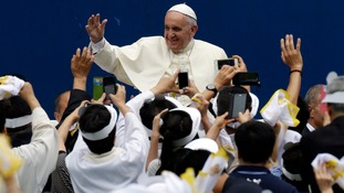 Pope Francis is greeted by the faithful upon his arrival for the Holy Mass at Daejeon World Cup stadium in Daejeon.