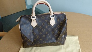 A Louis Vuitton bag is among the items being auctioned on eBay