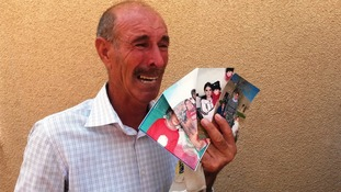 Hudaidah Mostapha Haji cried as he showed pictures of his lost family.