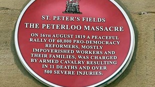 A plaque commemorating those who died and were injured