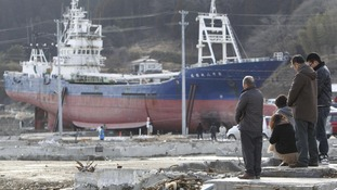 Moment of silence close to the 330 ton fishing vessel which was flung 800 meters inland from Kesennuma