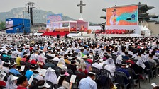 Faithful attend a mass led by Pope Francis at Gwanghwamun Square in Seoul August 16, 2014. F