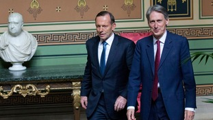 Tony Abbott, left, and UK Minister Philip Hammond.