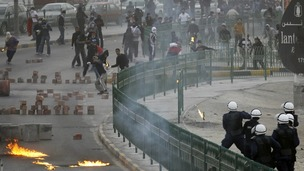 Anti-government protesters clash with riot police in Bahrain during the state's uprising.