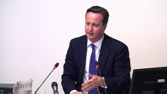 Prime Minister David Cameron giving evidence to the Leveson Inquiry