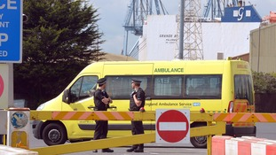 An ambulance drives into Tilbury docks.