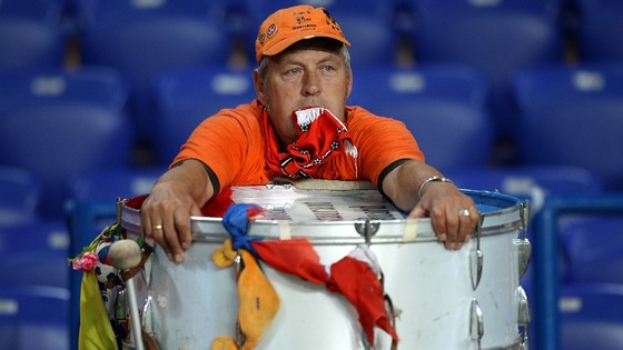 Dutch fan with drum in shock after defeat to Germany
