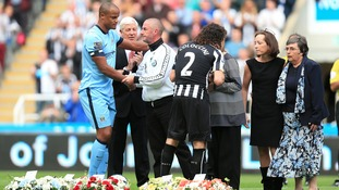 Barry Sweeney embraces Manchester City captain Vincent Kompany