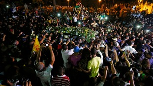Supporters crowd around a cart carrying the coffin of the late Brazilian presidential candidate
