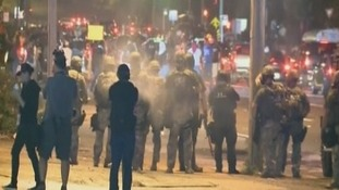 Smoke canisters 'fired at protesters'