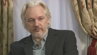 WikiLeaks founder Julian Assange speaking at the Ecuadorian embassy in London.