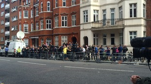 Journalists arrive outside the Ecuadorian embassy ahead of the press conference.