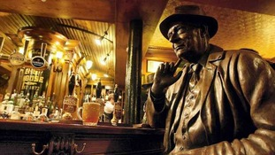 Statue of LS Lowry installed at the bar of Sam's Chop House
