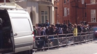 The media throng outside the Ecuadorian embassy.