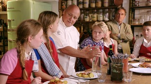 Chef speaks to children at table
