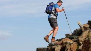 Man walking to the summit of Snowdon