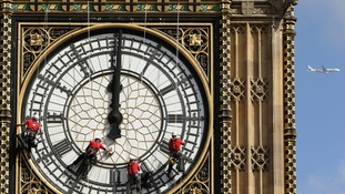 Abseilers clean the faces of Parliament's Great Clock
