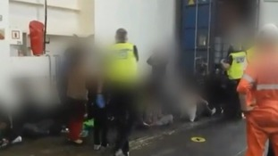 The footage shows people in distress as they are released from the container