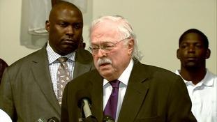 Dr. Michael M. Baden said six bullets struck Michael Brown.