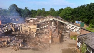 Men charged with Chilford Hall arson attack