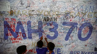 Children sign and MH370 memorial board.