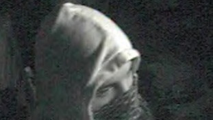 This man, who has covered his face, is also being sought by police.