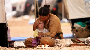 refugee woman from the minority Yazidi sect, who fled the violence in the Iraqi town of Sinjar.