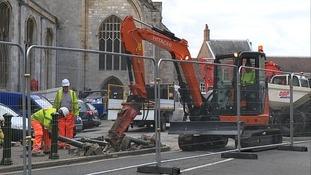 Workmen breaking ground