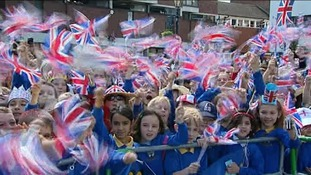 Children greet the Queen