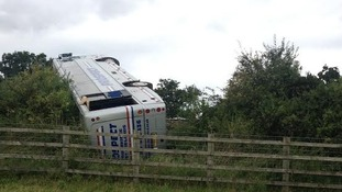 Coach overturns on M5