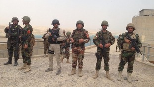 Kurdish Peshmerga fighters on top Mosul Dam after their victory.