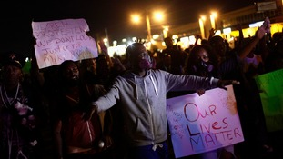 Demonstrators protest the shooting death of Michael Brown, in Ferguson