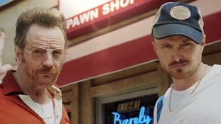 Cranston and Paul play staff at the Barely Legal Pawn Shop.