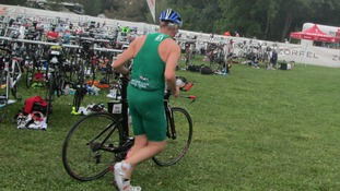 Paul Nash with his racing bike at a previous triathlon.