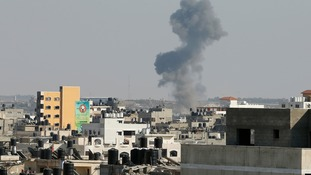 Smoke is seen after what witnesses said was an Israeli air strike in Gaza City yesterday.