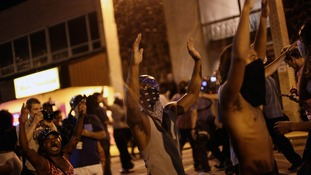 Protests continued in Ferguson last night over a week after Mr Brown was shot dead.