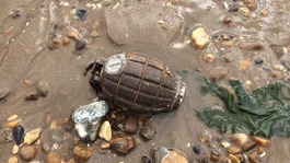 Signs put up on beach to warn about grenades