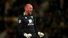 Norwich City's John Ruddy celebrates Bradley Johnson's winner.