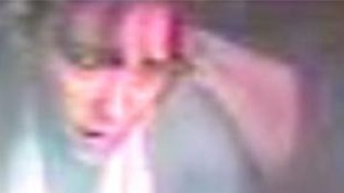 A CCTV picture of the woman who may have witnessed the attack.