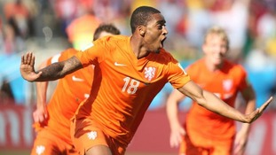 Leroy Fer celebrates scoring for Holland at the World Cup.