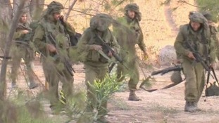 Troops filmed marching near the border with Gaza.