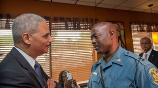 Attorney General Eric Holder talks with Capt. Ron Johnson of the Missouri State Highway Patrol