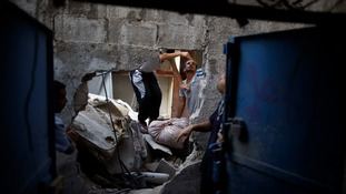 Palestinians inspect their house that witnesses said was destroyed during an Israeli airstrike in the north of Gaza