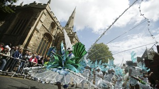 A carnival atmosphere is brought to Bedford, as the Bedford River Festival carnival parade makes it way through the town.