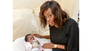 Two-week-old Ammra, pictured with mum Onyi Chiedozie, was holding her own bottle at three days old.
