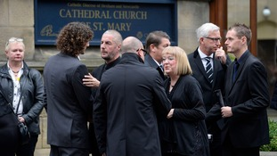 They were seen comforting the Sweeney family including Liam's father Barry (second left) and mother Angela (right).